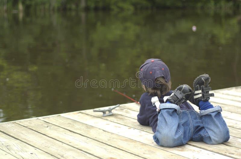 Weinig jongen visserij royalty-vrije stock afbeeldingen