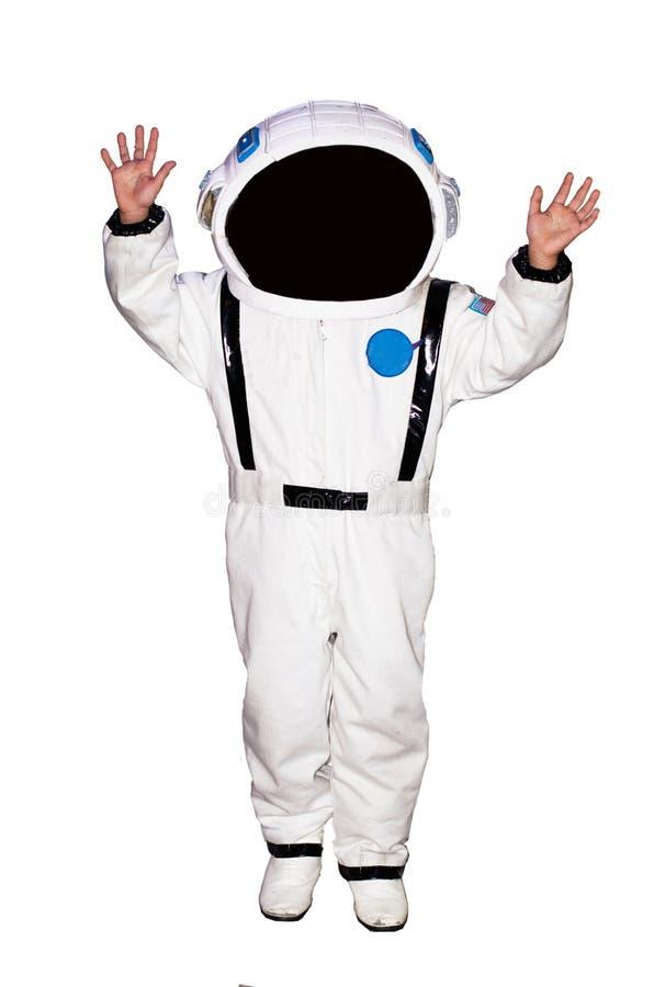 Weinig jongensastronaut op witte achtergrond royalty-vrije stock afbeelding