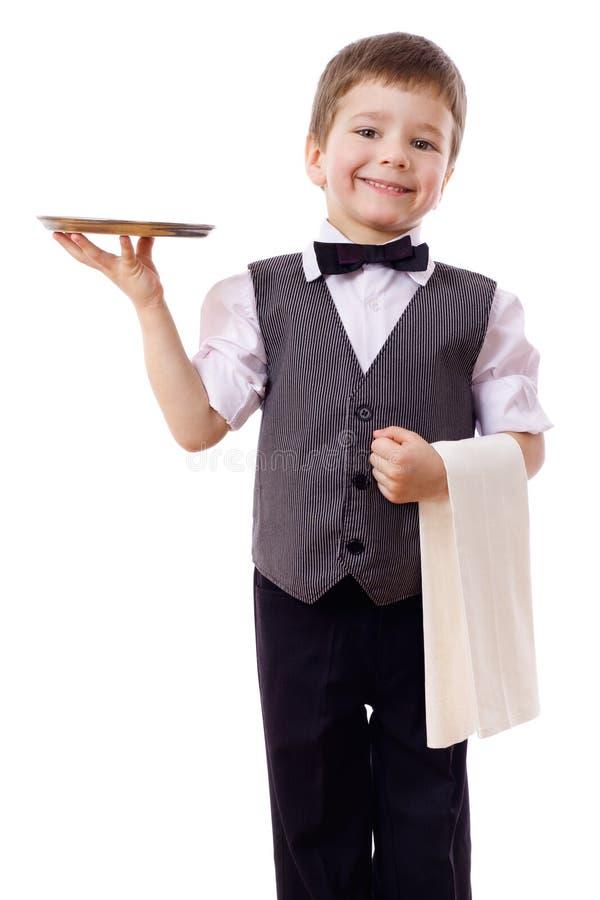 Weinig kelner met dienblad en handdoek stock foto