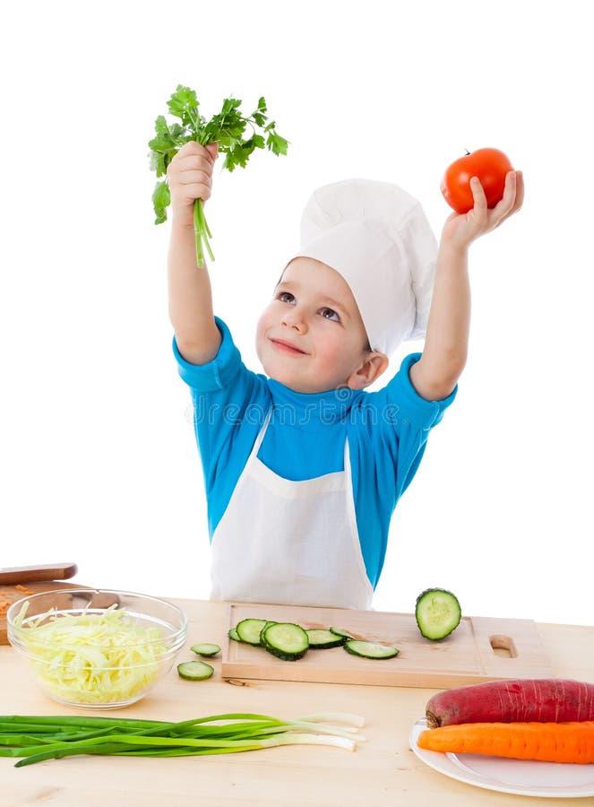 Weinig kok met peterselie en tomaten stock afbeelding