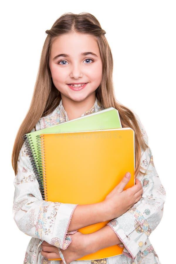 Weinig notitieboekje van de studentenholding stock foto