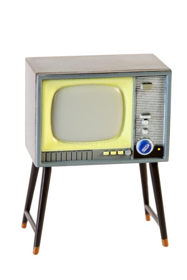 Weinig retro televisie die op wit wordt geïsoleerdd stock fotografie