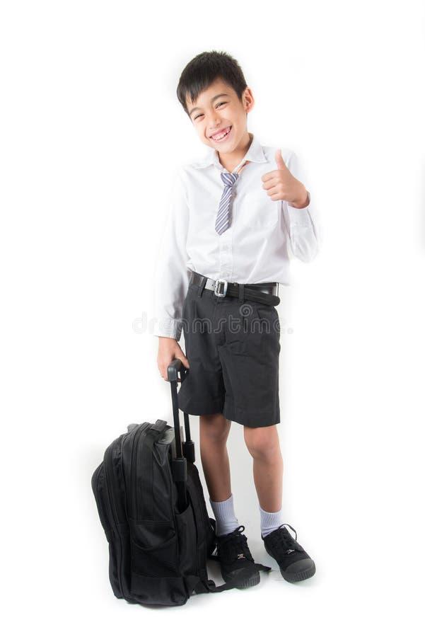 Weinig schooljongen die student eenvormig voor de eerste dagschool dragen royalty-vrije stock foto