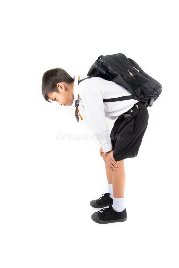 Weinig schooljongen die student eenvormig voor de eerste dagschool dragen royalty-vrije stock afbeelding