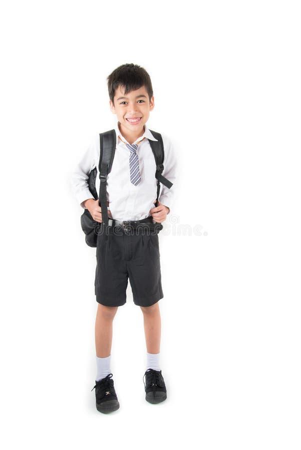 Weinig schooljongen die student eenvormig voor de eerste dagschool dragen royalty-vrije stock fotografie