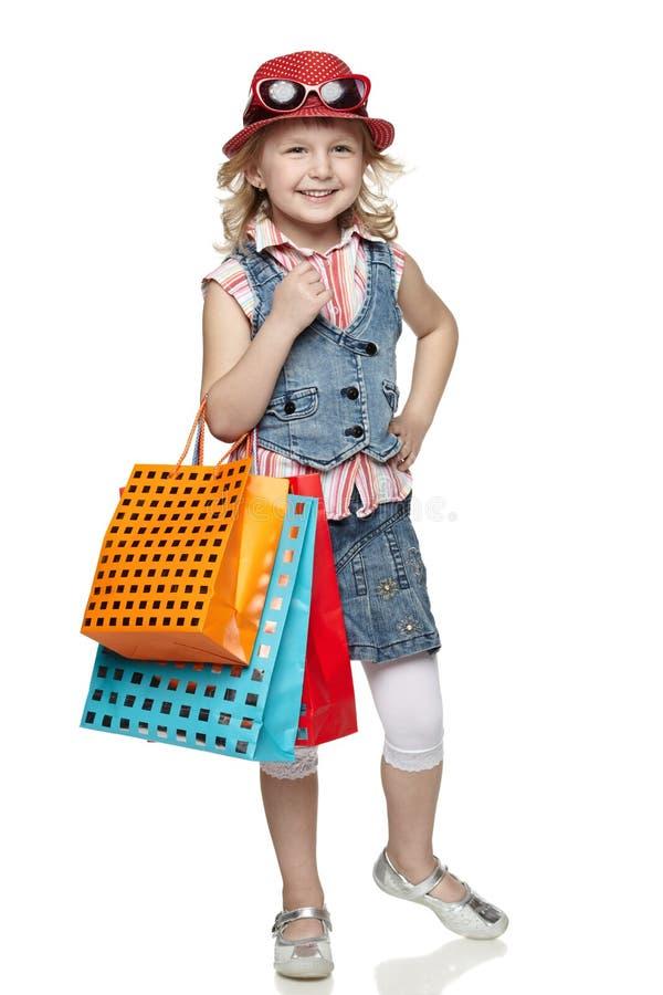 Weinig winkelend meisje stock foto