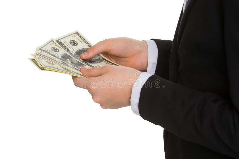 Weinig zakenman tellend geld. stock afbeelding