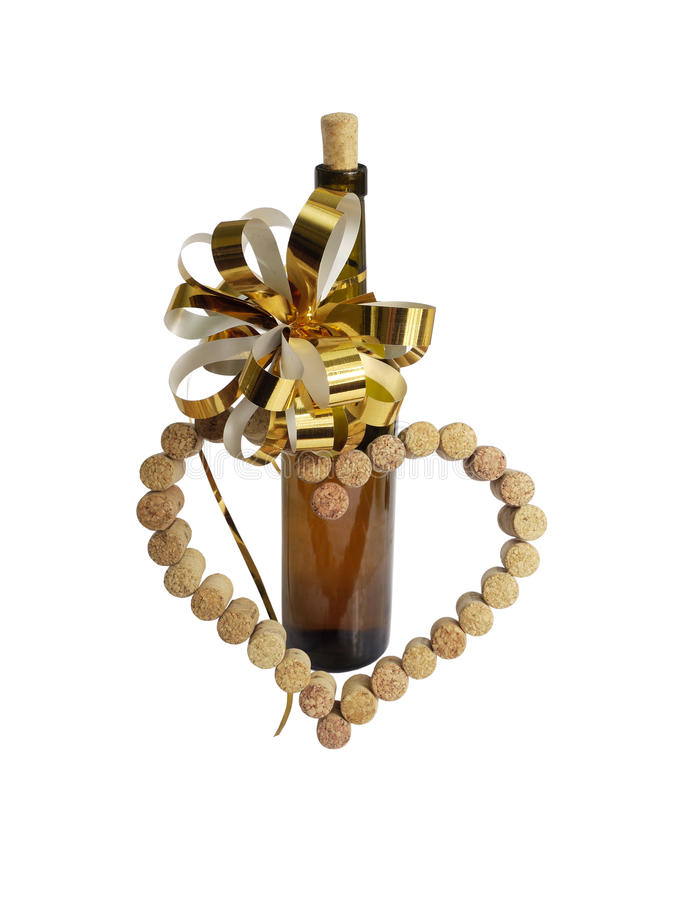 Weinkorken in Form des Herzens und einer Flasche Weins lizenzfreie stockbilder