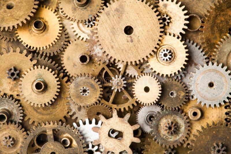 Weinlese übersetzt Makroansicht Gealterte mechanische Uhr dreht Hintergrund Flache Schärfentiefe, Weichzeichnung lizenzfreie stockfotos