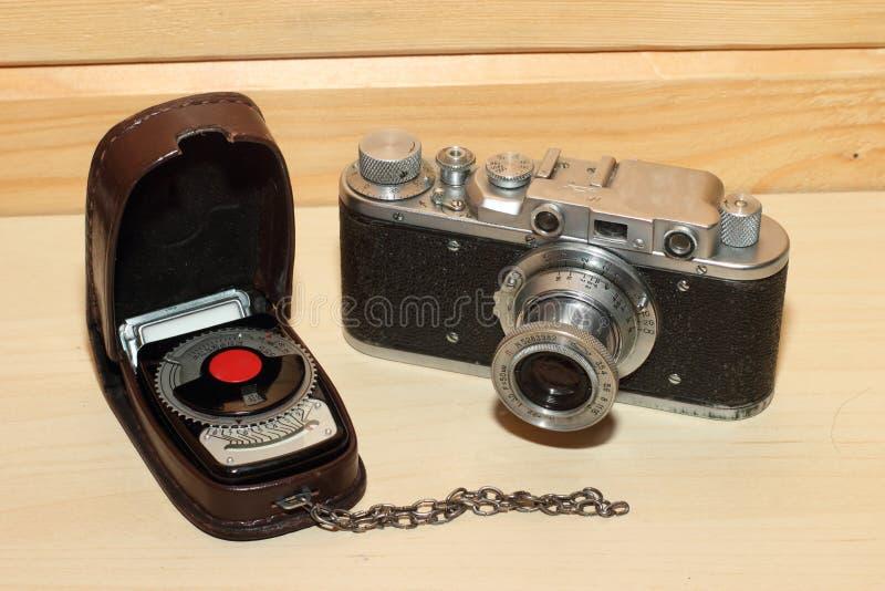 Weinlese cameraand Belichtungsmesser stockbilder