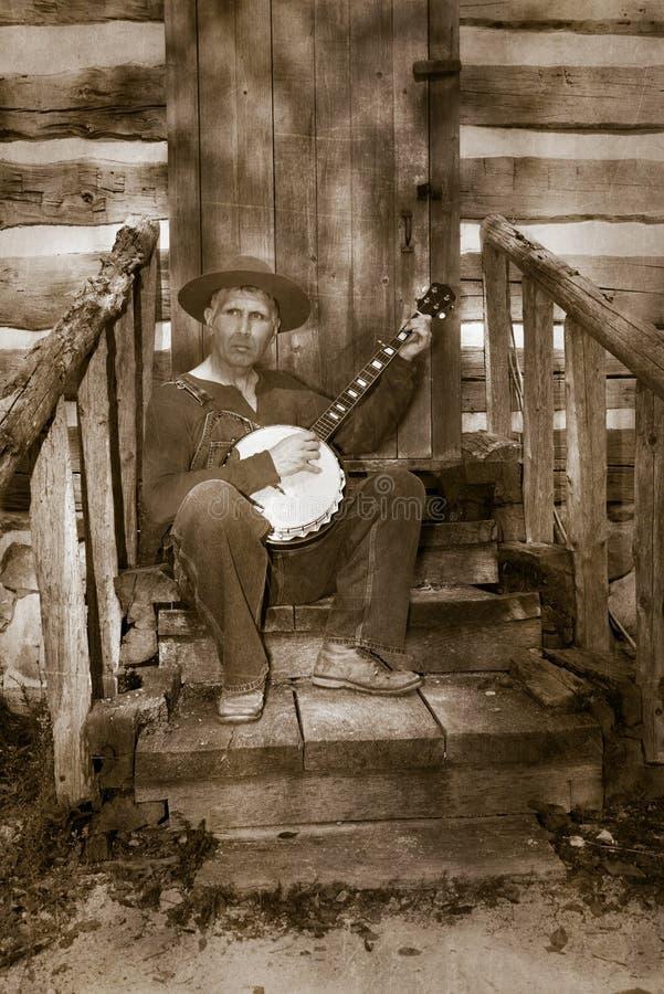 Weinlese-Hinterwäldler, weißer reaktionärer Hinterwäldler, Banjo-Spieler lizenzfreies stockbild