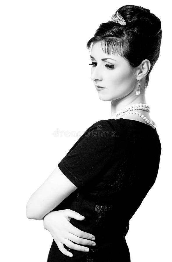 Weinlese-Porträt einer schönen jungen eleganten Frau lizenzfreies stockbild