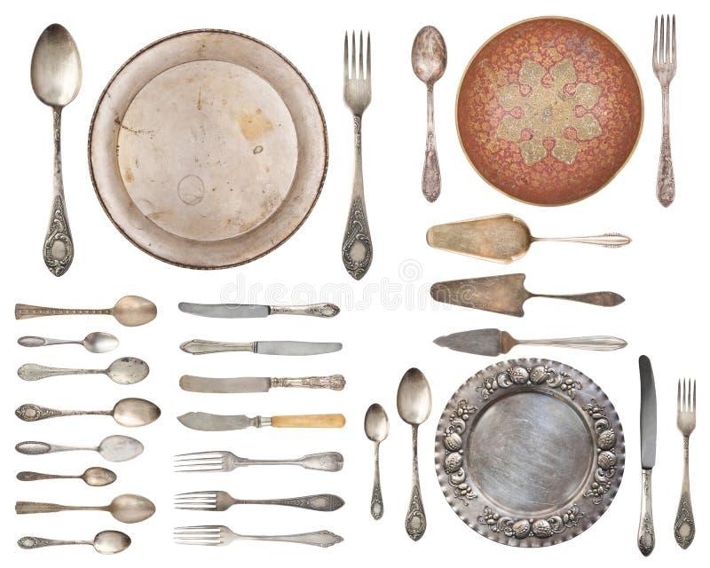 Weinlese-Tafelsilber, antike L?ffel, Gabeln, Messer, Sch?pfl?ffel, Kuchenschaufeln lokalisiert auf lokalisiertem wei?em Hintergru lizenzfreie abbildung
