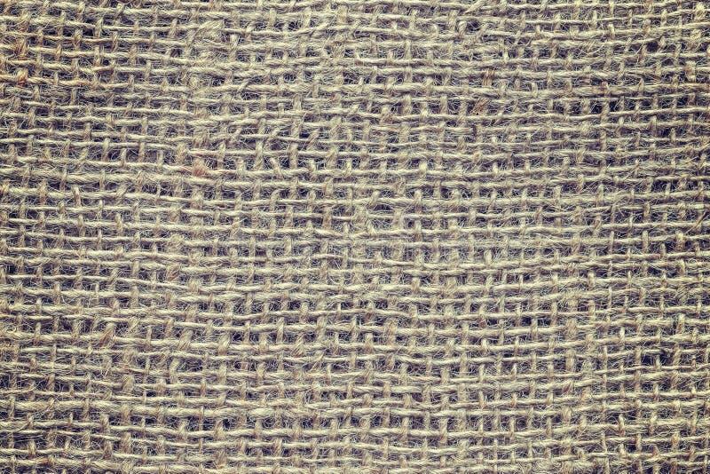 Weinlese tonte nah herauf Bild des natürlichen Jutefasergewebes stockfoto