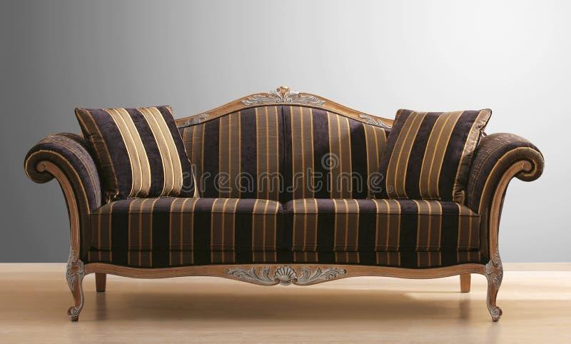Weinlesecouch oder -sofa lizenzfreie stockbilder