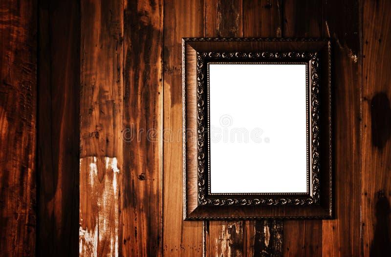Weinlesefotorahmen auf Schmutzholzwand stockfotos