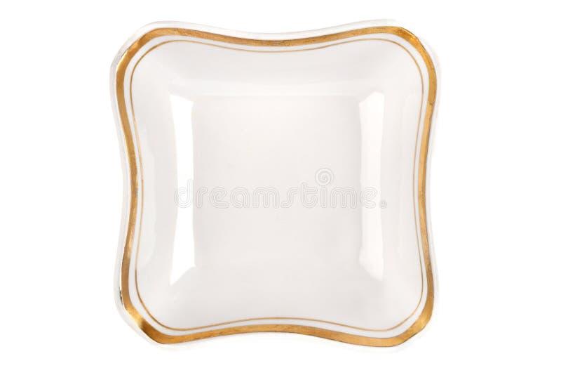 Weinleseplatte der ungewöhnlichen Form mit der Goldkante lokalisiert Draufsicht der Schüssel lizenzfreies stockbild
