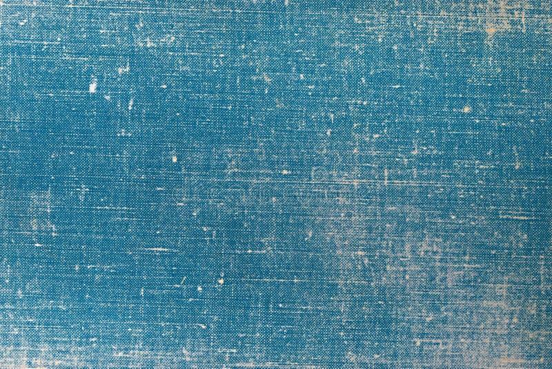 Weinlesestoff-Bucheinband mit einem Muster des blauen Schirmes und Schmutzhintergrundbeschaffenheiten stockbilder