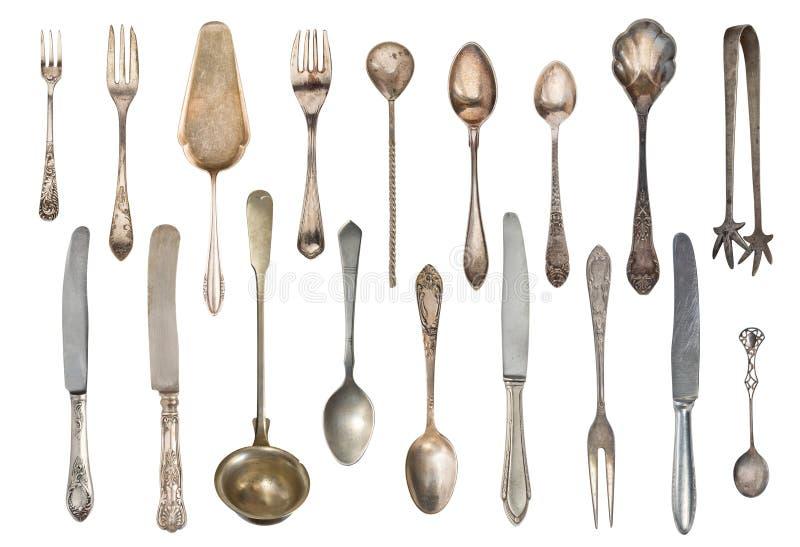 Weinleseteelöffel, Gabeln, Zuckerzange, Kuchenspachtel, Messer lokalisiert auf weißem Hintergrund Antikes Tafelsilber lizenzfreie stockfotos