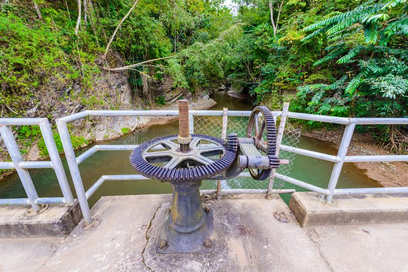 Weir or Dam at Wang Sila Laeng, Thailand. Old gear and rusted cogwheel mechanism, cog gear wheel for watergate, Weir or Dam at Wang Sila Laeng, Thailand stock photos