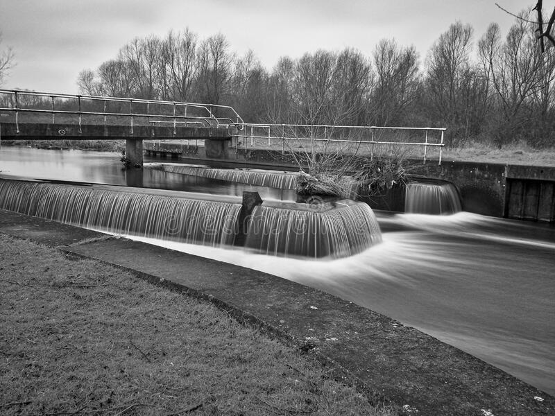 Weir and river stock images