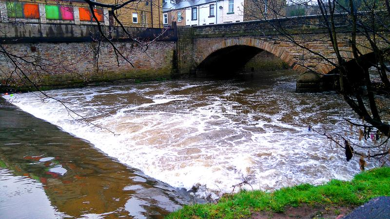 Weir in the river Calder in Padiham lancashire. This river flows through the Lancashire Town of Padiham. It is prone to flooding and in former years has put the stock images