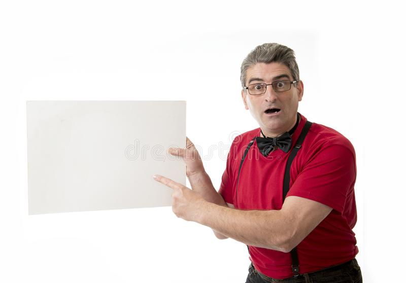 Weird and funny 40s to 50s crazy sales man with bowtie and red s stock photo