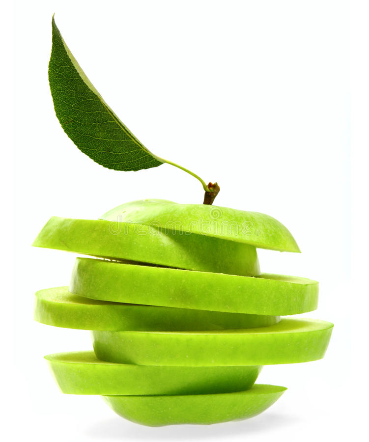 Weird Green Apple. Ripe fresh green apple cut with leaf isolated on white royalty free stock photos