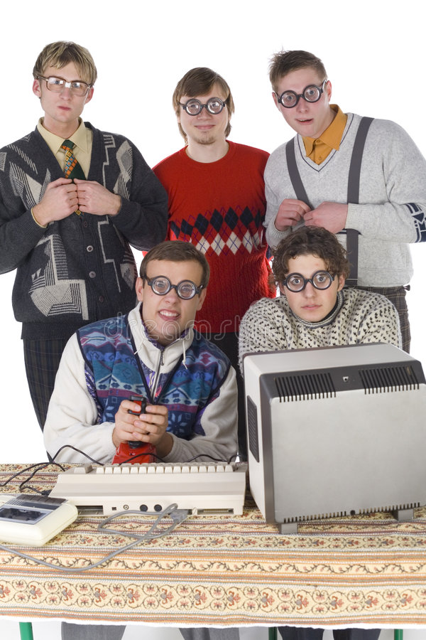 Weird guys. Five nerdy guys looking at camera. Two of them are sitting in front of old-fashioned computer. Others are standing behind them. They are looking very royalty free stock photography