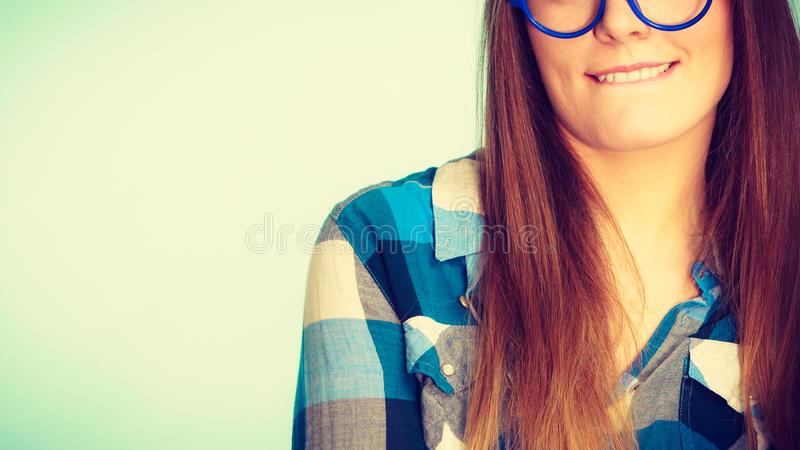 Weird nerdy woman in big glasses royalty free stock photos
