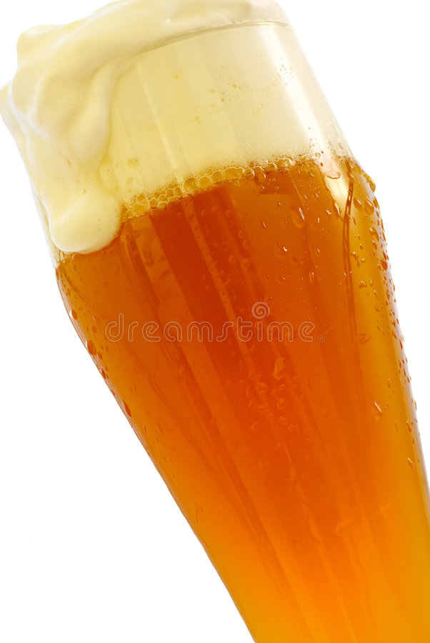 Weissbier. Typical Bavarian Weissbier as closeup on white background stock image