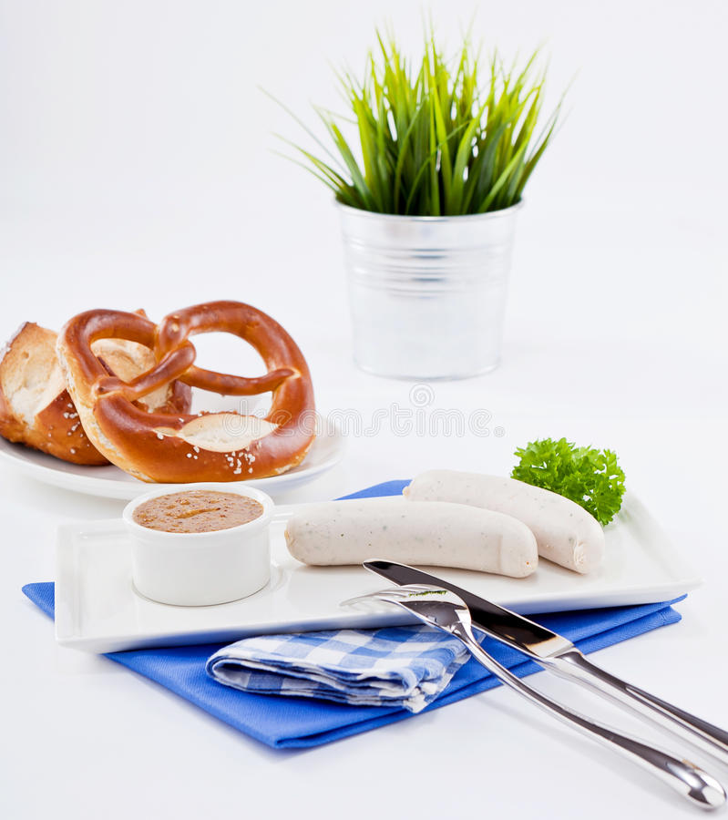 Weisswurst white sausages and sweet mustard with pretzel stock images