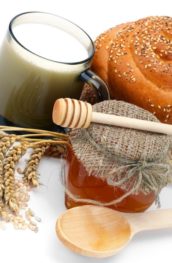 Weizenbrot mit Honigglas stockfotos