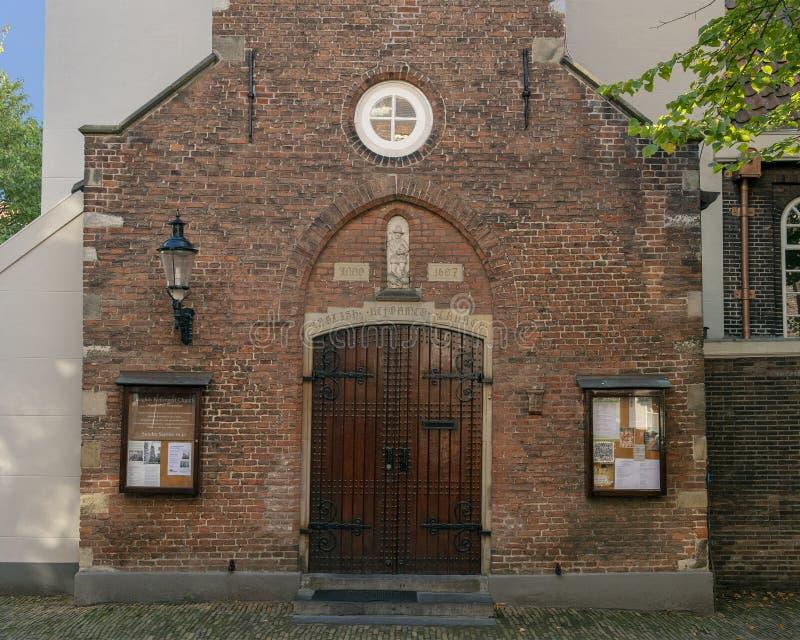 Wejście Angielski Reformowany kościół, Begijnhof, Amsterdam holandie zdjęcia royalty free