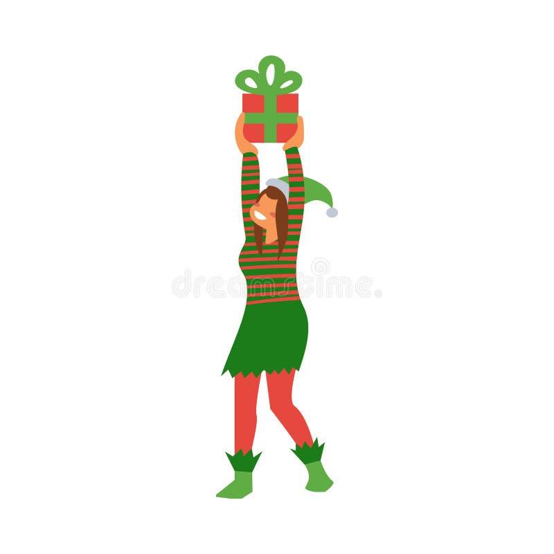 Wektorowa ilustracja żeński elf w zieleni i czerwony pasiasty kostiumowy mienie zawijał prezenta pudełko ilustracja wektor