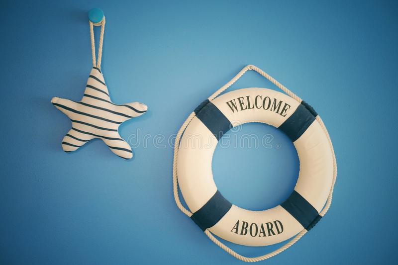 A welcome abroad lifesaver on a wall stock images
