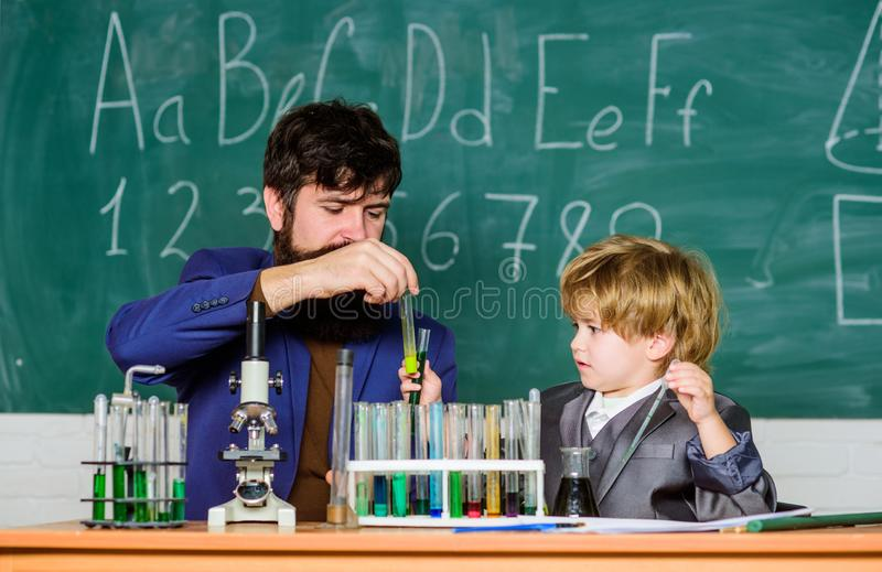 Welcome back to the city of learning. Wisdom. Back to school. training room with blackboard. small boy with teacher man. Son and father at school. Flask in stock images