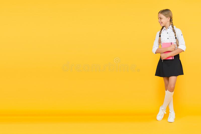 Welcome back to school. Inspirational quotes motivate kids for academic year ahead. School girl formal uniform hold book. School lesson. Study literature stock images