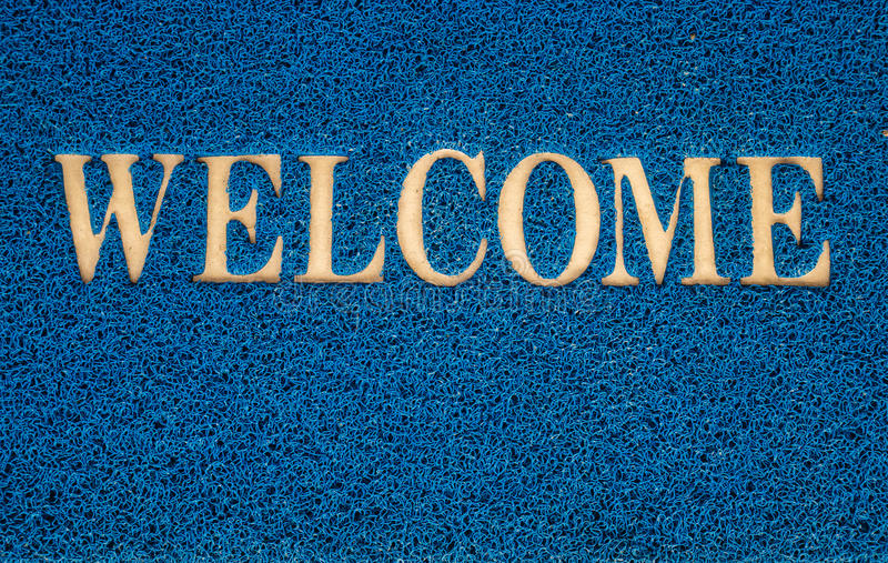 Welcome carpet at the door texture background. Welcome carpet at the door texture background royalty free stock photo