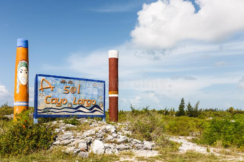 Welcome Cayo Largo del Sur sign with two high piles cigars, cloudy sky stock images