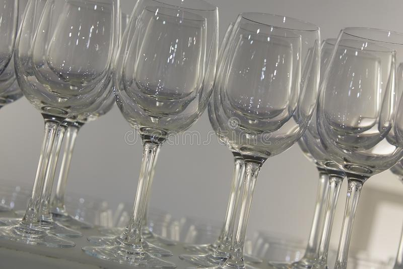 Welcome drink. Rows of empty wine or champagne glasses close up. glass goblets on the white table. Empty crystal royalty free stock images