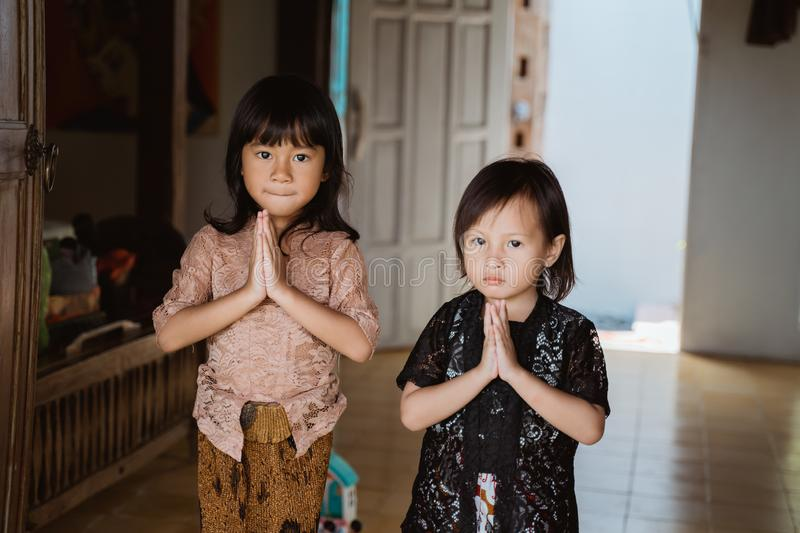 Welcome greeting from two asian little girl stock photo