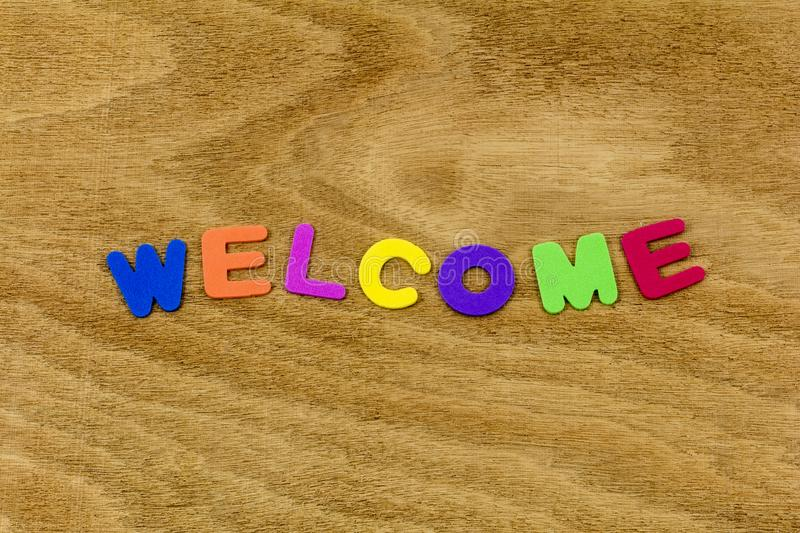 Welcome greeting wood color children letters plastic. School learning preschool learn learning happy spelling letter teaching teach royalty free stock photography