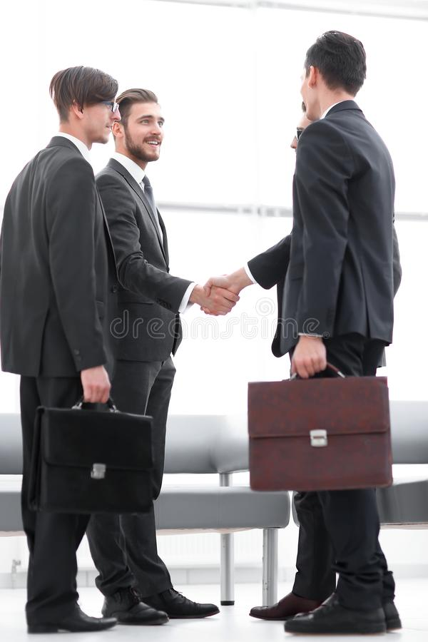 Welcome handshake of business partners royalty free stock image