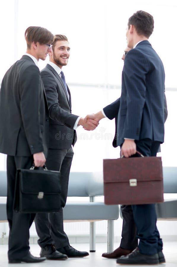 Welcome handshake of business partners stock photo