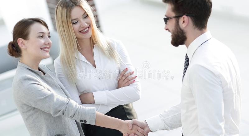 Welcome and handshake of business partners stock photography
