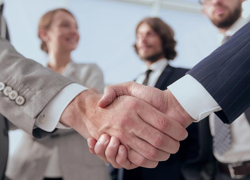 Welcome and handshake business people stock images