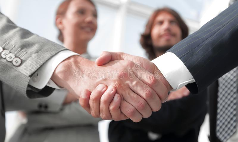 Welcome and handshake business people stock photo