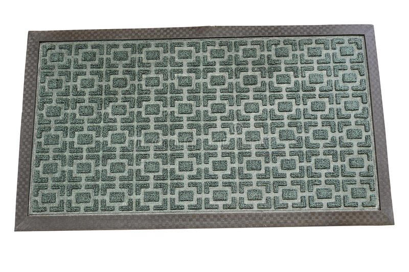 Welcome mat. Dark green welcome mat isolated on white background royalty free stock photo