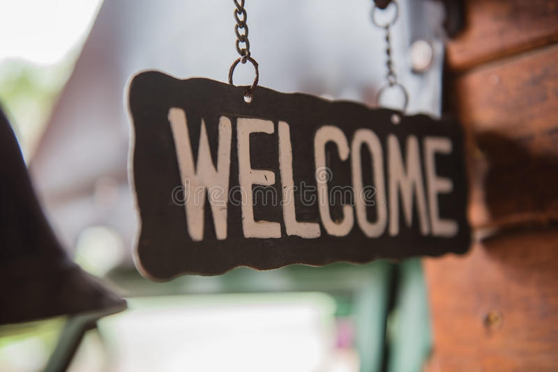 """""""welcome"""" metal label and old style, vintage tone. """"welcome"""" metal label and old style, vintage tone stock photo"""